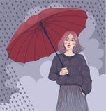 Mädchen mit einem Regenschirm Stockbild
