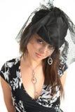 Mädchen mit einem Schleier auf ihrem Kopf Stockbild
