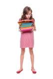Mädchen mit einem Stapel Büchern Stockfoto