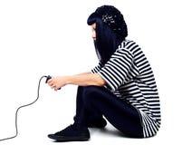 Mädchen mit einem Steuerknüppel stockfoto