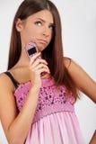 Mädchen mit einem Telefon Stockfotografie
