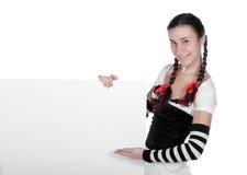 Mädchen mit einem unbelegten Zeichen Lizenzfreie Stockbilder