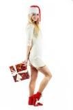 Mädchen mit einem Weihnachtsgeschenk Stockbilder