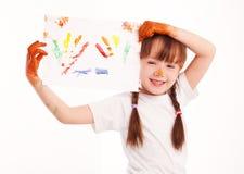 Mädchen mit einer Abbildung Stockbild