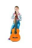 Mädchen mit einer Gitarre Stockfotos