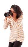 Mädchen mit einer Kamera Stockbild