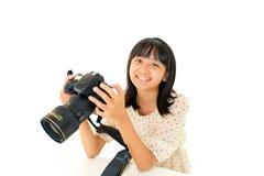 Mädchen mit einer Kamera Stockfotografie