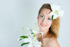 Mädchen mit einer Lilie lizenzfreie stockbilder