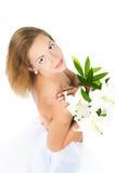 Mädchen mit einer Lilie stockbilder