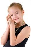 Mädchen mit einer Perlenschnur Stockfotos