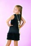 Mädchen mit einer Perlenschnur Lizenzfreie Stockfotos