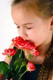 Mädchen mit einer Rose Stockbild