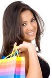 Mädchen mit Einkaufenbeuteln Stockfotos