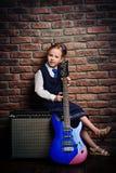Mädchen mit elektrischer Gitarre Stockbilder