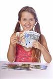 Mädchen mit Geld Stockfotos