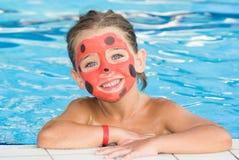 Mädchen mit gemaltem Gesicht Lizenzfreie Stockfotos