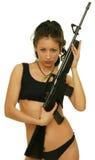 Mädchen mit Gewehr Stockfoto