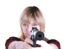 Mädchen mit Gewehr Stockbild