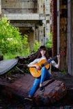 Mädchen mit Gitarre Stockfotos
