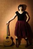 Mädchen mit Gitarre Stockbilder