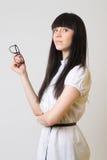 Mädchen mit Gläsern Stockfoto