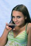 Mädchen mit Glas Wein. Stockbild