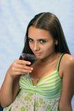 Mädchen mit Glas Wein. Stockfoto