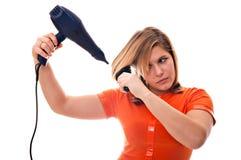 Mädchen mit hairdryer Lizenzfreie Stockfotografie