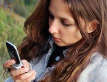 Mädchen mit handlichem Lizenzfreie Stockfotografie