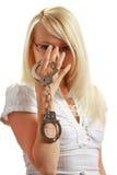 Mädchen mit Handschellen Stockfoto