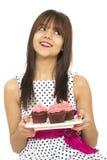 Mädchen mit kleinen Kuchen Stockfotografie