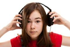 Mädchen mit Kopfhörern Lizenzfreie Stockfotos