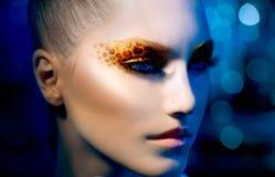 Mädchen mit Leopard-Make-up Lizenzfreies Stockfoto