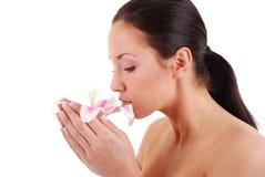 Mädchen mit Lilienblume Stockfoto