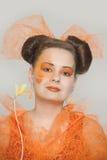 Mädchen mit orange Make-up Lizenzfreies Stockbild