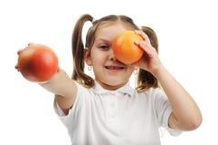 Mädchen mit Orangen Lizenzfreies Stockbild