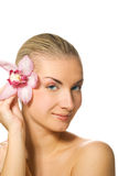 Mädchen mit Orchideeblume Lizenzfreies Stockfoto
