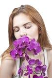 Mädchen mit Orchideen Lizenzfreies Stockbild