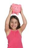 Mädchen mit piggy Querneigung stockfoto
