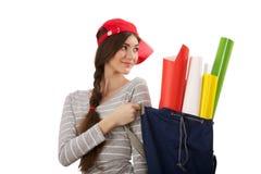 Mädchen mit Rolle des Papiers Stockfoto