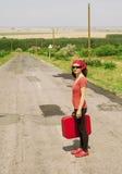 Mädchen mit rotem Koffer Stockbild
