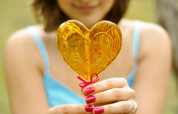 Mädchen mit Süßigkeit Stockbilder