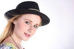Mädchen mit schwarzem Hut Lizenzfreies Stockfoto
