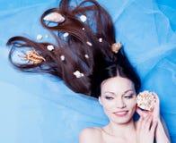 Mädchen mit Seashell Lizenzfreie Stockfotos