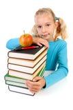 Mädchen mit Stapel der Bücher Lizenzfreie Stockbilder