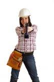 Mädchen mit Sturzhelm und Bohrgerät lizenzfreies stockfoto