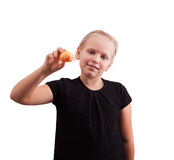 Mädchen mit Tangerine in der Hand Stockbild