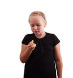 Mädchen mit Tangerine in der Hand Stockfotografie