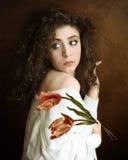 Mädchen mit Tulpen Stockbild