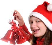 Mädchen mit Weihnachtsglocke Stockfoto